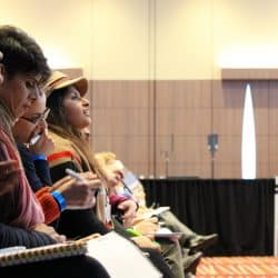 people listening and making notes at a property investment summit